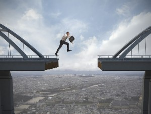 businessman-jumping-gap